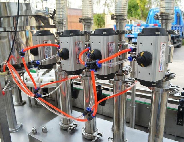 Máquina de llenado y taponado de botellas de PET de control PLC